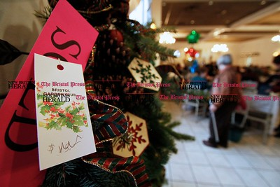 Kevin Bartram | Staff Holiday items for sale are featured during the Bristol Garden Club's annual holiday luncheon on Monday at the Farmington Club in Farmington. The event featured a demonstration by floral designer Tina Calcagni of Berlin.