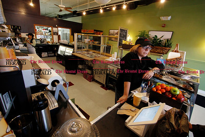 Kevin Bartram | Staff Alice Chiovoloni works behind the counter as Cafe Beauregard opens for business on Tuesday at 2 Main Street in New Britain. Alice and her husband Rob Chiovoloni own the restaurant.