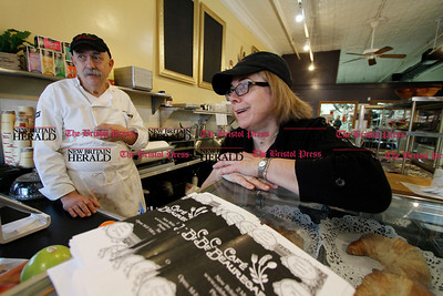 Kevin Bartram | Staff Rob and Alice Chiovoloni work behind the counter as Cafe Beauregard opens for business on Tuesday at 2 Main Street in New Britain.