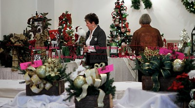Kevin Bartram | Staff Club members browse among the holiday items for sale during the Bristol Garden Club's annual holiday luncheon on Monday at the Farmington Club in Farmington. The event featured a demonstration by floral designer Tina Calcagni of Berlin.