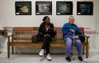 Kevin Bartram | Staff Tatiana McCoy, left, and Dolores Valitsky wait to see New Britain mayor Erin Stewart on Monday. Stewart met with the public during the first of the her office hours sessions on Monday at New Britain City Hall.