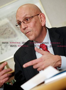 Kevin Bartram | Staff Bill Rivenburg, the manager of Bank of America's Main Street branch in New Britain, talks about the evolution of the banking business during an interview on Monday in New Britain.