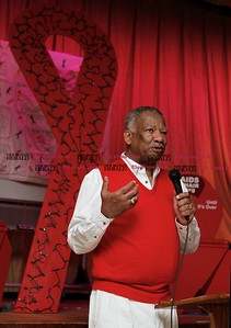 Kevin Bartram | Staff Frederick Smith from New Britain's Human Resources Agency speaks during a World AIDS Day observance sponsored HRA on Monday at South Church in New Britain. This year marked the 25th anniversary of World AIDS Day.