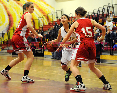 2/1/2013 Mike Orazzi | Staff New Britain's Ginelle Martinez (24) and Conard High School's Sarah Hoisl (22) and Rebekah Hoisl (15) at New Britain High School on Friday night.
