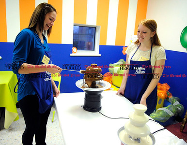 2/1/2013 Mike Orazzi | Staff Taylor Rivera and Darian D'Amato test a chocolate fountain during the First Friday Family Festival Cocoa Loco at the Imagine Nation Museum in Bristol on Friday evening.  ** for a Diane story ***
