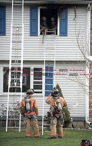 2/1/2013 Mike Orazzi | Staff Bristol firefighters on scene of a house fire on Lovers Lane in Bristol on Friday afternoon.