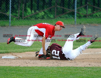 6/1/2013 Mike Orazzi | Staff Fairfield Prep 's David Gerics (44) tags out Bristol Central's Mitchell Guilmette (12) during a 6-2 Prep win over Bristol Central in the Class LL Quarterfinals at Muzzy Field on Saturday night.