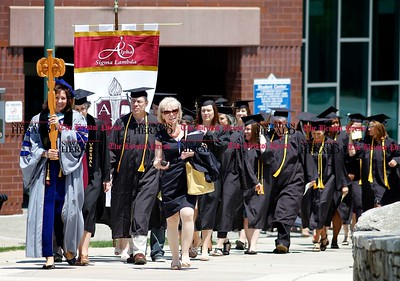 Kevin Bartram | Staff Graduates march to Welte Hall during the Charter Oak College graduation on Sunday on the campus of Central Connecticut State University in New Britain. Charter Oak offers online degree programs and accelerated completion plans.