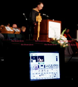 Kevin Bartram | Staff Sunday's Charter Oak College graduation at Welte Hall on the campus of Central Connecticut State University in New Britain is distributed via webcast as student John C. Thomas speaks. Charter Oak offers online degree programs and accelerated completion plans.
