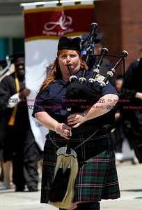 Kevin Bartram | Staff Tara Keating, a 2012 Charter Oak graduate, plays the bagpipes as she leads the Class of 2013 into gradution on Sunday at Welte Hall on the campus of Central Connecticut State University in New Britain. Charter Oak offers online degree programs and accelerated completion plans.