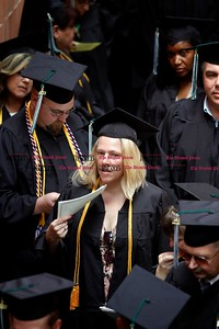 Kevin Bartram | Staff Ruth Paul tries to stay cool before the start of the Charter Oak College graduation on Sunday on the campus of Central Connecticut State University in New Britain. Charter Oak offers online degree programs and accelerated completion plans.