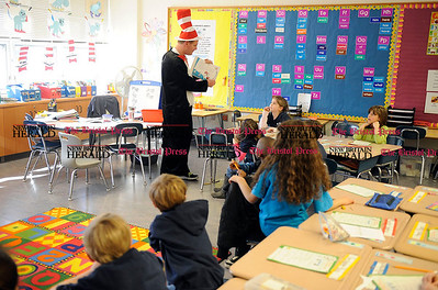 3/1/2013 Mike Orazzi | Staff Mt. View School Principal David Huber reads a Dr. Seuss book to Gian Martineau's first grade class on Friday.