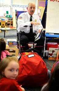 3/1/2013 Mike Orazzi | Staff Bristol Fire Marshal Denis Peri reads to children at the Mt. View School on Friday.