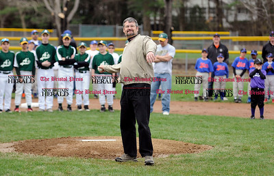 4/20/2013 Mike Orazzi | Staff Bristol Councilman Kevin Fuller throws out the first pitch on opening day at the Forestville Little League in Bristol on Saturday morning.