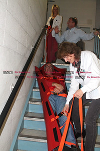 "BRISTOL, Conn. — As part of Bristol Hospital's emergency operations training, hospital staff spent Friday undergoing training in the event that patients have to be evacuated due to a weather emergency or power outage. Bristol Hospital is collaborating with Russell Phillips and Associates, a consultant that has been revising the hospital's full building evacuation plan which includes the use of med sleds and stair chairs to transport patients down stairwells.   Taking part in the training involving a med sled is Clinical Dietitian Susan Markus, RD, who maneuvers hospital Boiler Operator Ken Rondeau who plays the ""patient."" At the top of the stairs, Clinical Dietitian Kimberly Dompier, RD, CD-N, receives instructions from Jim Garrow, fire and emergency management consultant for Russell Phillips and Associates."