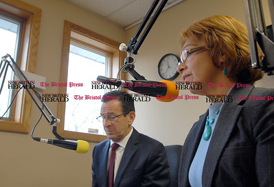 "Johnny Burnham | Staff Gov. Dannel Malloy takes part in the ""Hablando en Serio"" readio show on WPRX Friday in Berlin. LPRAC Commissioner Lourdes Montalvo served translates for the spanish radio station."