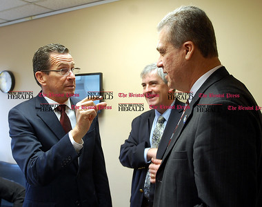 Johnny Burnham | Staff Gov. Dannel Malloy speaks with State Rep. Edwin Vargas, right, and New Britain Mayor Timothy O'Brien at WPRX in Berlin Friday.