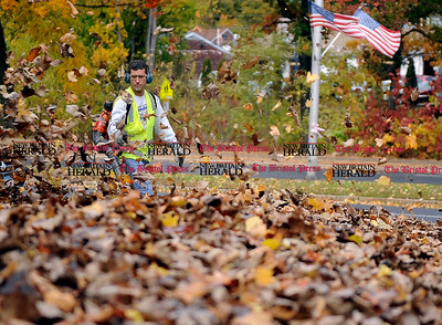 11/1/2013 Mike Orazzi | Staff Bristol Parks & Recreation employee Dean Dionne while working on leaves off Memorial Blvd. on Frida afternoon.