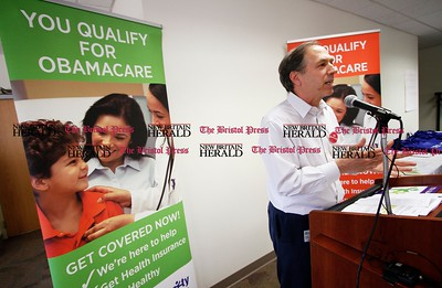 Kevin Bartram | Staff Community Health Center, Inc. president and CEO Mark Masselli speaks during an Affordable Care Act enrollment fair for patients at the center in New Britain on Tuesday. Tuesday was the first day to apply for health insurance under the Affordable Care Act.