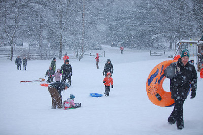 Sledders arive at the hill