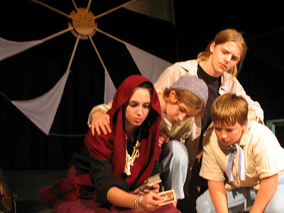Medea's children (Anastasia Aleander; Alden Shoemaker) and their Tutor (Dune Mayberger) watch the Nurse (Nicole Morris, YTP Master) turn over her cards in search of finding signs of the future for Medea