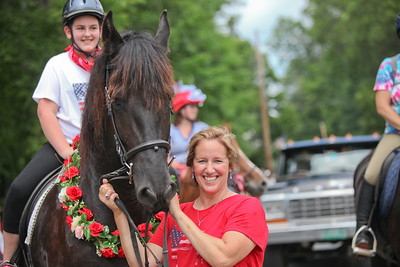 Becky Nott holds a horse ridden by Madison Sweeney