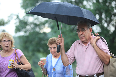 left2right Myra, Grosinger, Ronnie Giordano, Carmine Giordano run inside to escape the rain