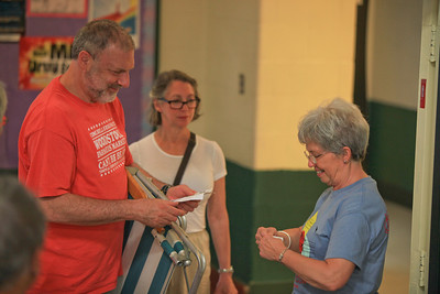 left2right Elliot Rubin, Joan Rubin get their ticket checked by a VSO Volunteer