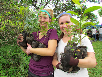 Asa Waterworth and Ana Haimovitz carring tree seedlings from our nursery