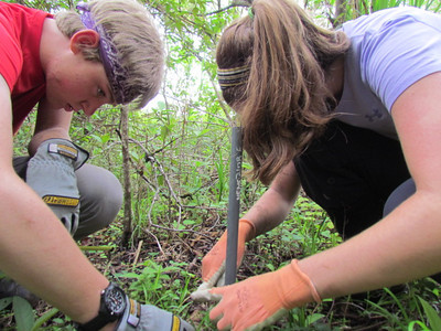 Jack Greene and Kristin Ramsey reforesting the corridor