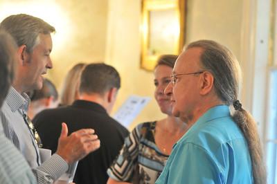 Arturo Delmoni (right) Talks with voulenteers