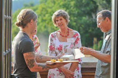 Left2right Anne Macsoud, Anne Dean, Nigel Hollis enjoy appetizers served by Ian Campbell (left) 2
