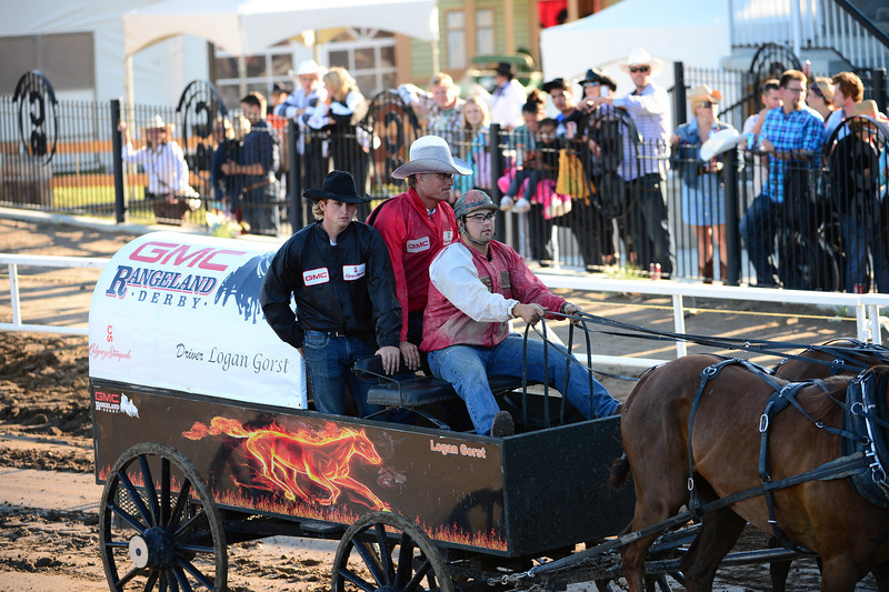The gentleman in the red jacket is Bob Thompson President & Chairman of the Stampede Board.  This was his first ride in a chuckwagon run