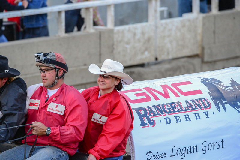 Everyday of the chuckwagon races they do a practice run to show the folks just how the race is run.  They take a guest with driver and todays lady looks like she enjoyed the ride.