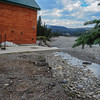 mountain aire lodge after the flood on the red deer river - pump house balancing in the wind