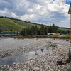 mountain aire lodge after the flood on the red deer river - pump house sits prcariusly on the rivers edge after the land washed away
