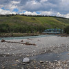 mountain aire lodge after the flood on the red deer river - the bridge survived