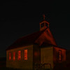 Dorothy Ab.is a ghost town.....catholic church with a 15 watt bulb inside...looks like a service is going on...