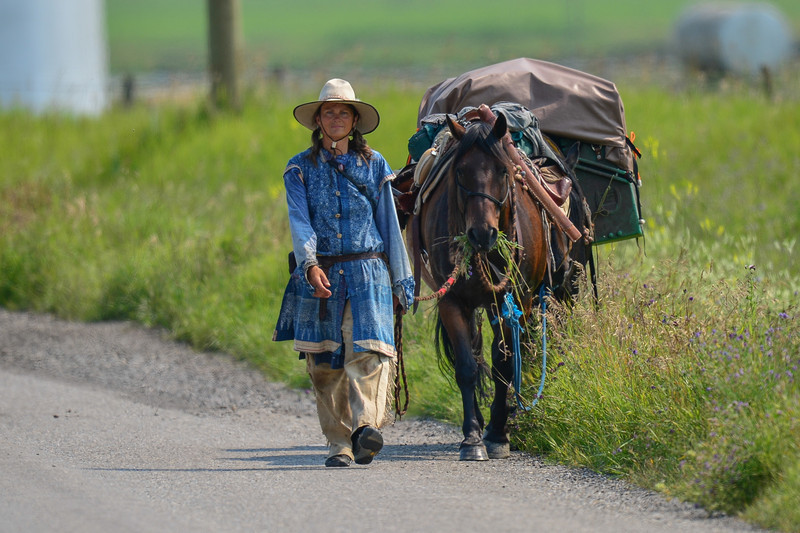 """The lady (Catherine) on the last leg of her long ride.  Our paths just happened to cross again when I was out searching for photo subjects.  I first met Catherine on June 25.  Her and her horses have been traveling like this for nearly 3 months.<br /> You can read about her long ride on her blog here: <a href=""""http://fiain-skuld.blogspot.ca"""">http://fiain-skuld.blogspot.ca</a><br /> Good Luck on your final leg Catherine!"""
