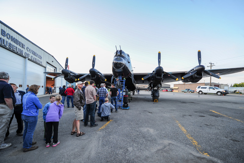 getting ready for the night start up...it has been 54 years since this Lancaster had 4 engines running.  This Lancaster was flown to the Uk in 1945.  Canadian-built Lancaster FM159 was to late for the war.  It was flown back, put in storage, flown buy the RCAF during the fifties, and  in 1959 flown to an old airfield 28 kilometres east of Nanton.  Its engines and propellers were removed as the aircraft was prepared to be scrapped.  Three residents of Nanton bought the bomber, towed it home, and placed it on display next to Highway #2.  It was badly vandalized before being mounted for display where it sat for the next 30 years.  In 1986, a society was formed from the town's population of only 1600 and it audaciously annouced that, not only would it build a museum to honor Canada's huge contribution to Bomber Command, but that the aircraft would be restored to taxiable status with all four engines runn-able.<br /> This dream came true tonight!
