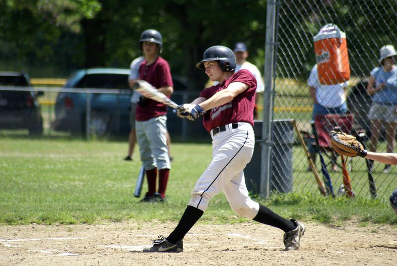 "Josh Lambert knocks it out! See the rest of the photos under "" Josh Tri Valley Summer League Baseball""  GREAT FACE JOSH!"