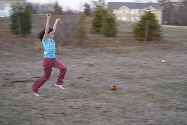 Bea mid leap for her front flip in our back yard....Easter evening...still cool and she's not affected. This one made POTD , the rest of the shots with Family Wiffle Ball and mom/Bea facing off on handstands are there too....See Easter evening working off Dinner pics!
