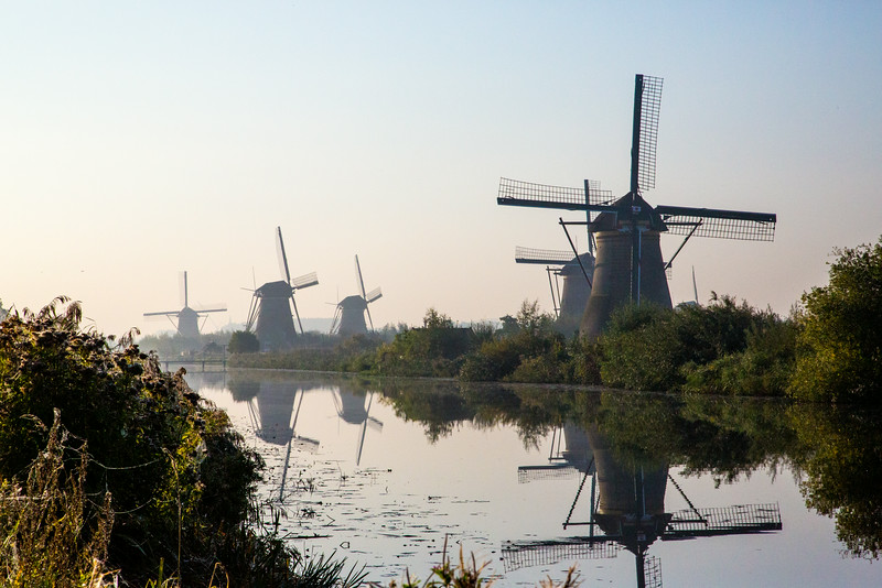 Windmills along a canal in Kinderdyk, Netherlands