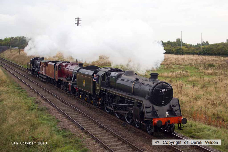 131005-003     A triple header, BR standard 5 no 73129 leads LMS 8F 48624 & BR standard 2 78019, captured passing Woodthorpe bridge, heading towards Quorn.