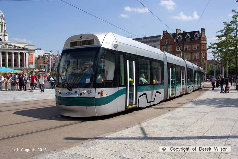 "130801-026     Nottingham Express Transit (NET) Incentro class tram no 203 William ""Bendigo"" Thompson, seen passing the old market square, heading out of the city, to Hucknall."