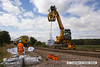 130830-011     Road Railer 99709 910013-0 takes a sack of ballast to the worksiteat Clipstone East, further back is Volker Rail tamper no DR75403. Clipstone West junction, in the distance, is also to be plain lined at some time in the not too distant future.