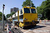 130801-019     Volker Rail track tampers no's DR75404 & DR75405 cross Colwick Road, heading into Nottingham for a share of the action.