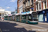 130801-027     Nottingham Express Transit (NET) Incentro class tram no 207 Mavis Worthington, captured on Market Street, approaching the old market square.