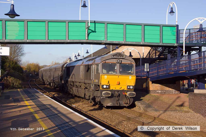 131204-001     Grey liveried GB Railfreight class 66/7 no 66749, captured passing through Mansfield Woodhouse, powering 7Z45, the 11.05 Doncaster, Roberts Road shed to Derby Etches Park sidings. Seen hauling a rake of eight unbranded Drax Power biomass hoppers, these were from the first set of the new biomass wagons to enter service.