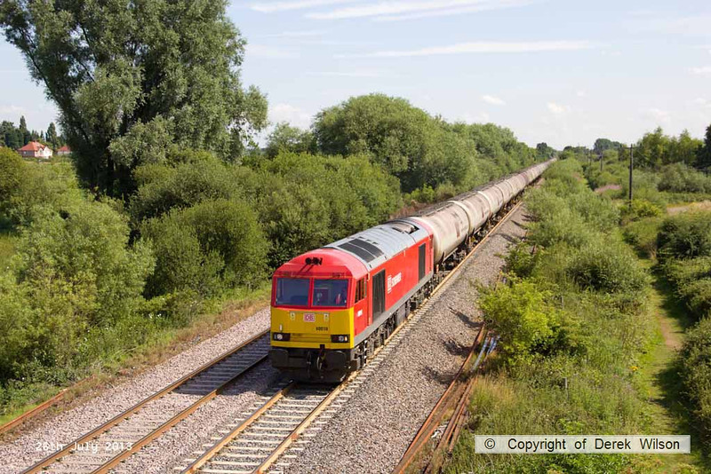 130726-019      DB Schenker class 60 no 60010 passes a sunny Willington, powering train 6M57, 05.58 Lindsey Oil Refinery to Kingsbury oil sidings, loaded fuel-oil tanks.